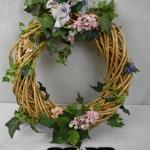 Wooden Wreath with Flowers & a Bow