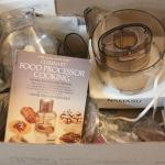 Lot 74 Food Processor w/ Accessories & Book