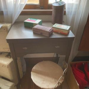 Photo of Lot 132. Singer sewing machine in table with attachments--$35