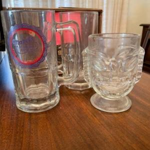 "Photo of Lot 120. One large glass beer stein ""Mabel's Whorehouse,"" one glass tiki v"