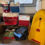 Lot 170. Four coolers, surfing sled, fins, air mattress, 2 pairs of goggles, etc