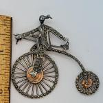 Lot JMO4: Large Silver and Marcasite Brooch of a person riding a penny farthing