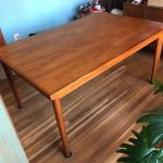Lot 189 - Sleek & Solid Wood Dining Table With Hidden Leaves