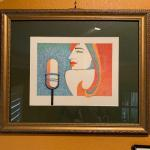 LOT 176  FRAMED LITHOGRAPH LADY WITH A MICROPHONE