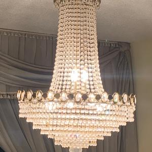 Photo of Crystal chandelier.  In good condition.
