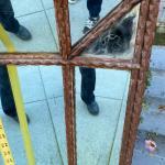 Antique tramp art wall mirror