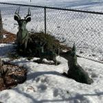 Group of concrete deer