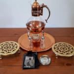 Lot 10: Serving Pieces including Copper Warming Teapot and Trivets.