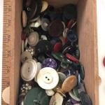 Unsorted box of buttons