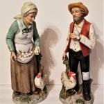 Lot #92  Pair of Bisque Porcelain Figurines - farmer and wife