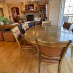 Gorgeous rustic custom kitchen table and six leather chairs