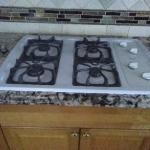 Whirlpool 30 inch- built in gas cooktop whit.  Works well and in good condition.