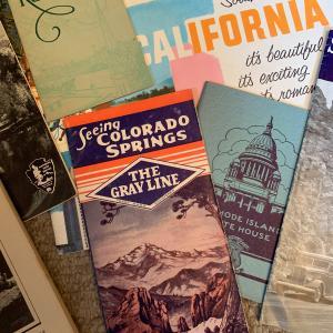 Photo of 17 vintage travel brochures and ephemera.