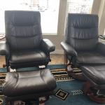 Two leather recliners with footstools