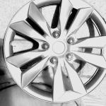 "Set of four brand new  16"" silver hubcaps"