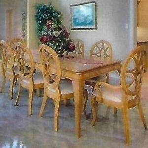 Photo of Dining Room Table with extra leaf and Ten Chairs (Ashley)