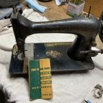 Old singer machine with attachments