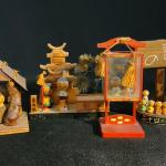 Lot 160: Miniature Kokeshi including Glass Encased Set