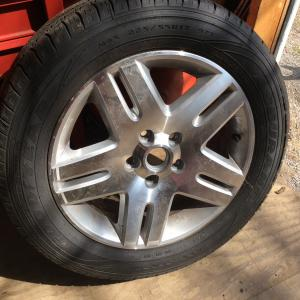 Photo of Brand new tire on brand new aluminum rim