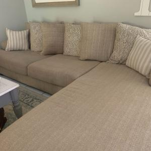 Photo of Sectional with large swivel chair