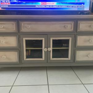 Photo of Entertainment center and coffee table