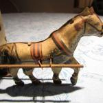 LOT 303  TIN HORSE DRAWN CARRIAGE TOY