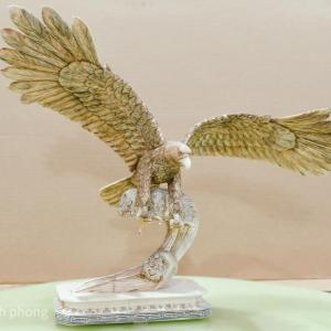 Photo of Bone Sculpture - An eagle swooping down to snatch a fish