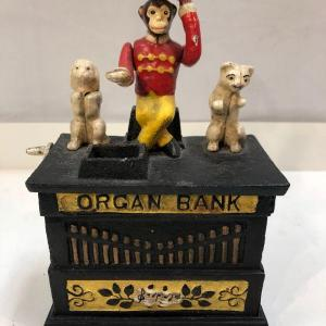 Photo of Cast Iron Organ Grinder Monkey Coin Bank