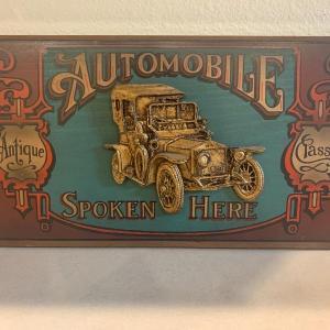 Photo of Vintage antique Automobile sign