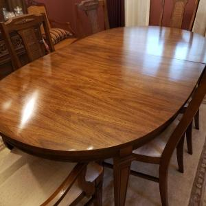 Photo of Oval dining room table with 3 leaves what are you complaining about what the gar