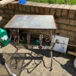 Antique wrought iron end table