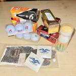 Lot 211  Group of Packaged & Souvenir Golf Balls Glove Tees