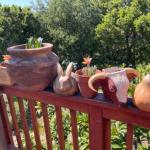 Lot 190G. Garden pottery and wall hangings (cow and rabbit), ceramic gourd--$45