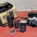 Lot 187G. Manuel Pentax camera, zoom lens, flash, two lens covers--$85