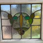 "Lot 183G. Vintage framed stained glass window (20"" x 17-1/2"")--$95"