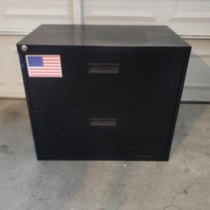 Photo of Black, steel filing cabinet.