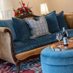 Leather couch w/ blue fabric cushions & pillows
