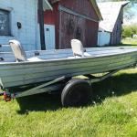 Fishing boat with trailer and trolling motor