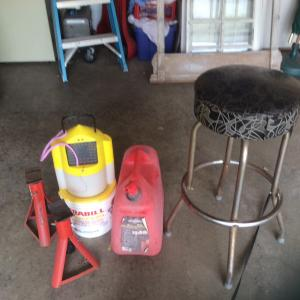 Photo of Jack stands, minnow buckets, gas can, and shop stool