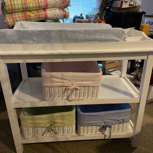 Photo of Pottery Barn Changing Table with baskets.