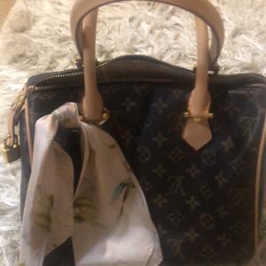 Photo of LV branded  Speedy bag