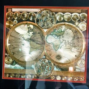 Photo of Framed metallic globe print