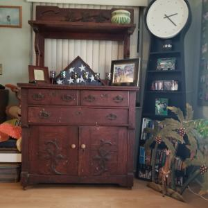 Photo of antique 2 peace cabinet