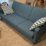 Teal blue sofa and bed