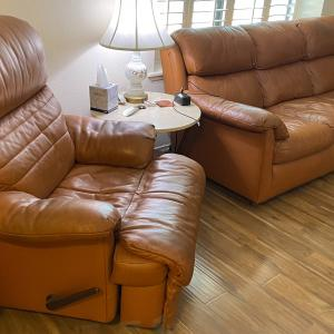 Photo of 2 Leather couches with recliner