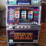 Aruze Gaming  tokens only slot machine