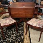 Wood table with four chairs (+ two table leaves)