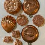 Collection of copper kitchen pan decor