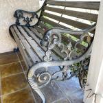 Lot 199  Vintage Heave Cast Iron Wood Slat Park Bench Gargoyle Head Arm Rests