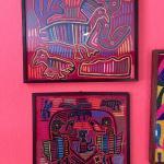 Item 36. Pair of Peruvian framed Kuna Mola textile art panels, bird scenes. Circ